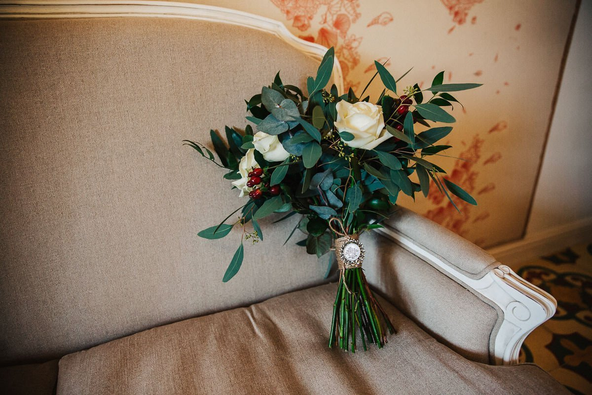 Winter wedding bouquet with berries and white roses