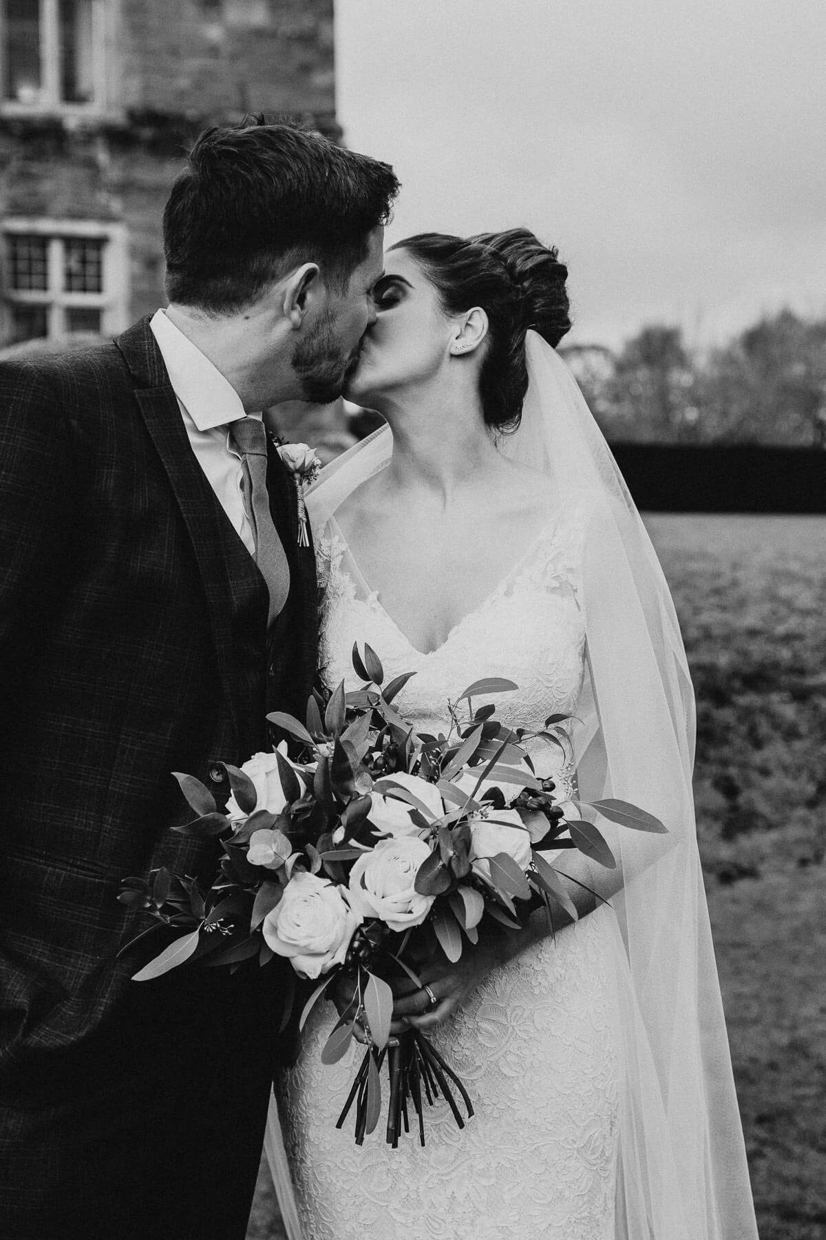 Couple kissing at their winter wedding