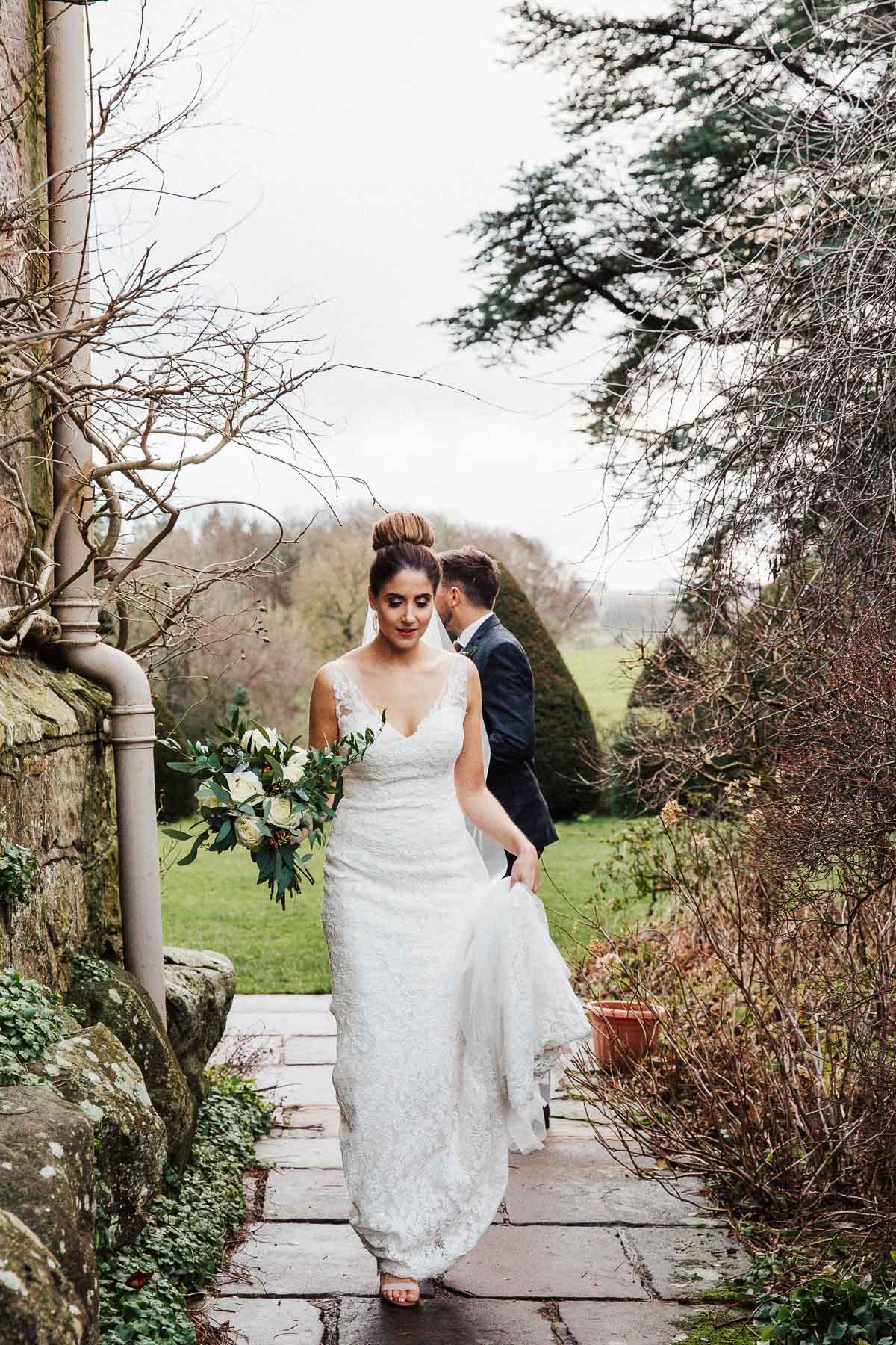 Winter bride walking in a lace dress