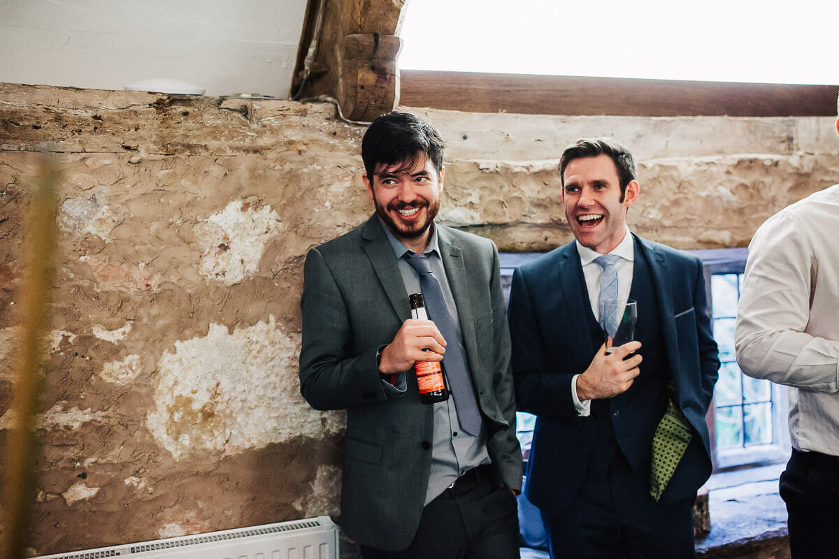 Guests laughing during the reception
