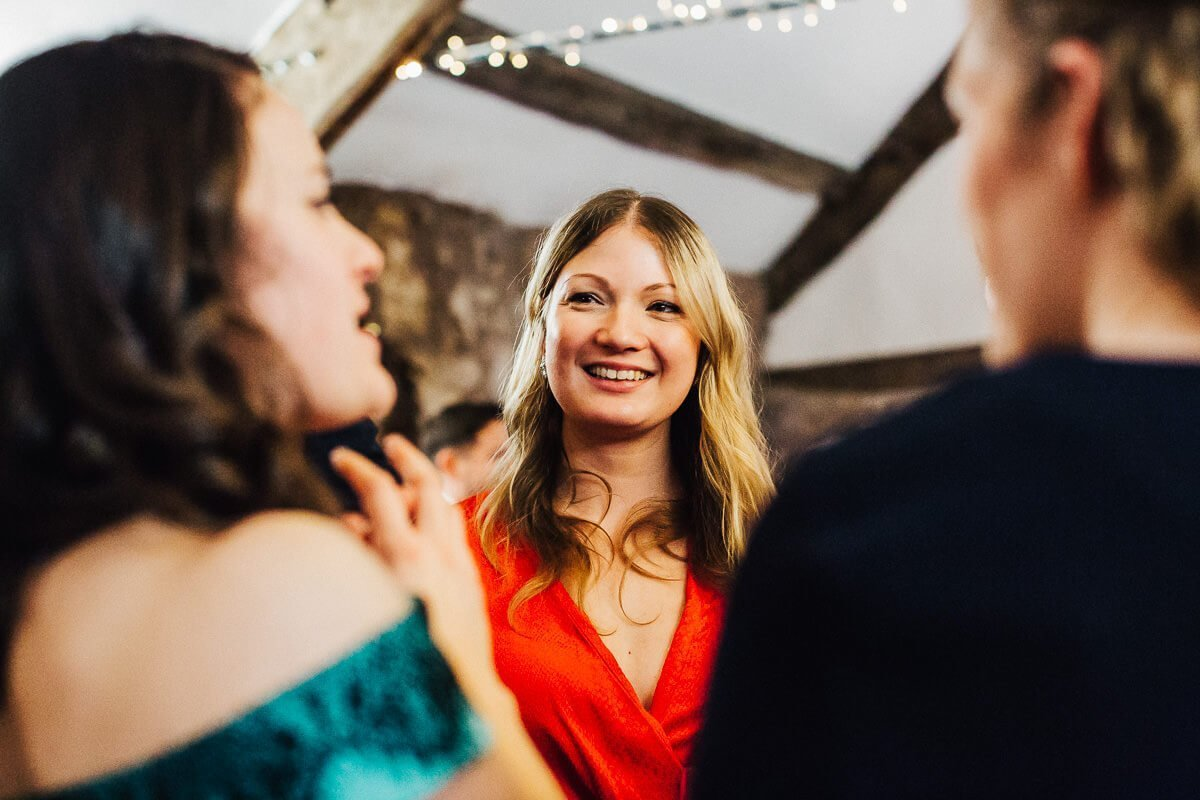 Wedding guest smiling at drinks reception