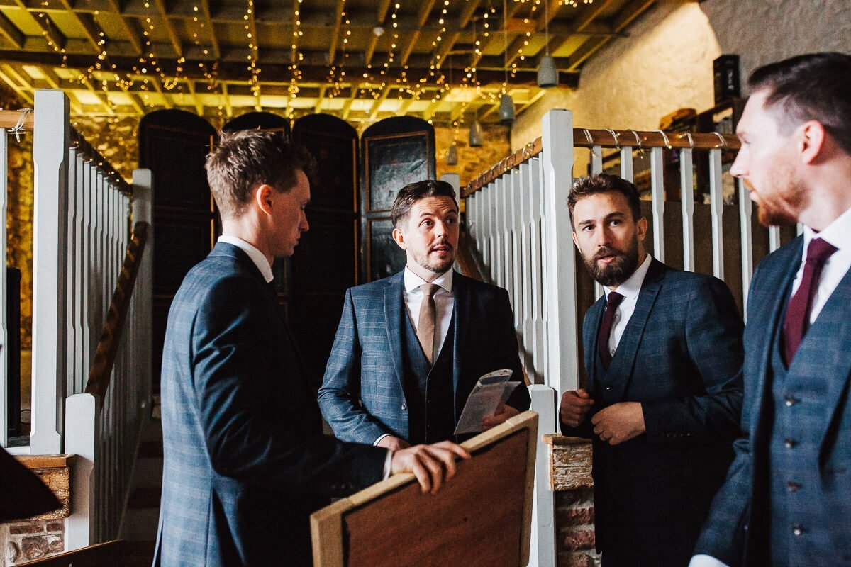 The groom and ushers in blue checked suits