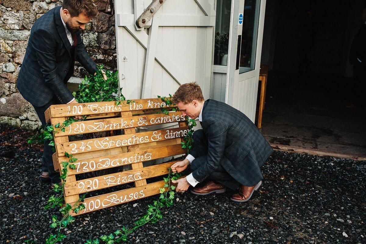 Ushers decorating the wedding sign