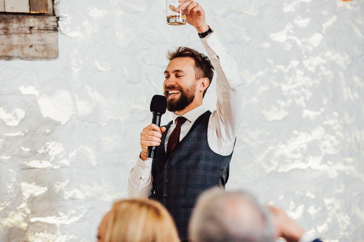 Best man raising a glass