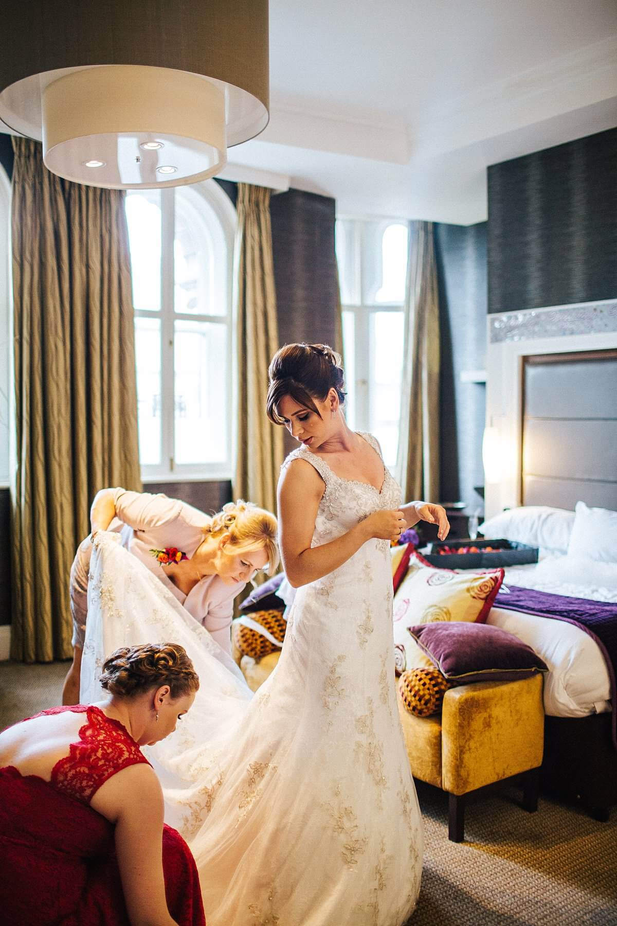 Beautiful wedding photograph of bride in her Demetrios dress