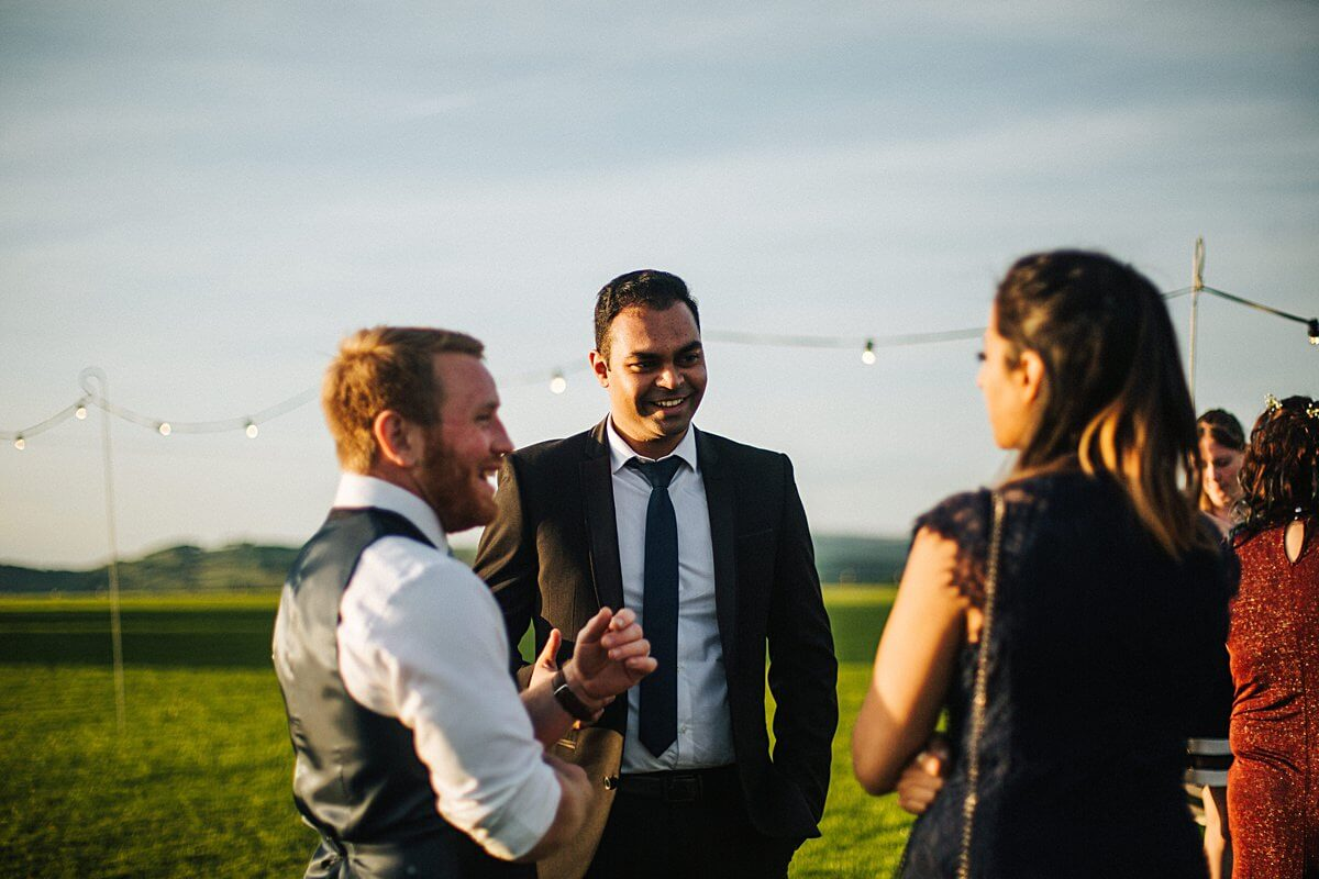 Natural photos of wedding guests at sunset