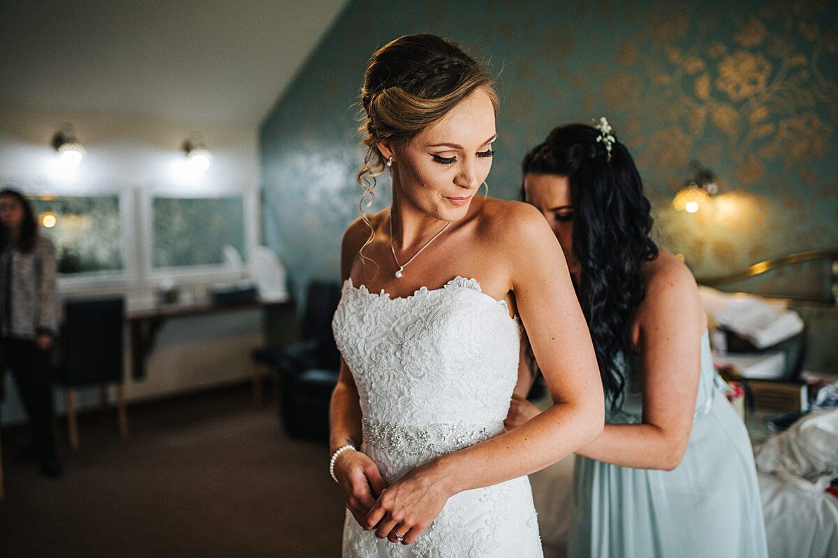 Beautiful bride in her lace dress
