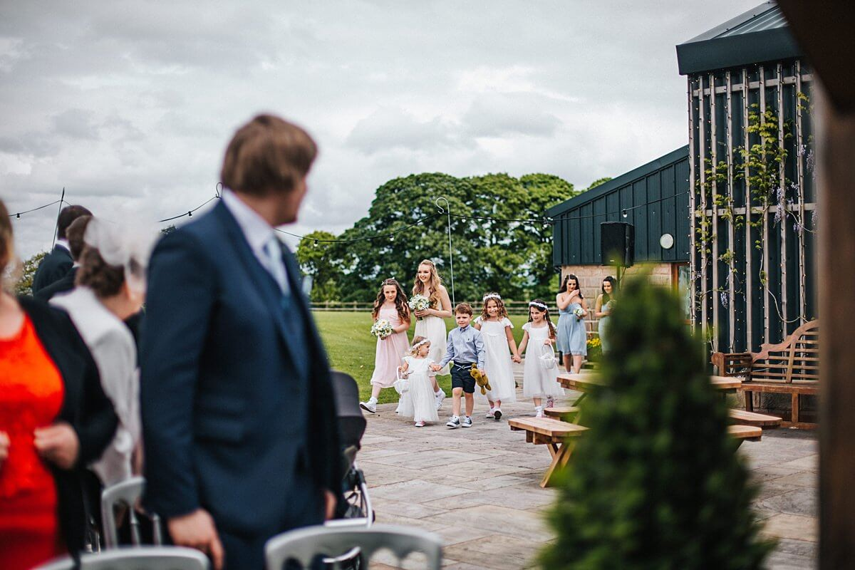 The bridal party arriving to the outdoor ceremony