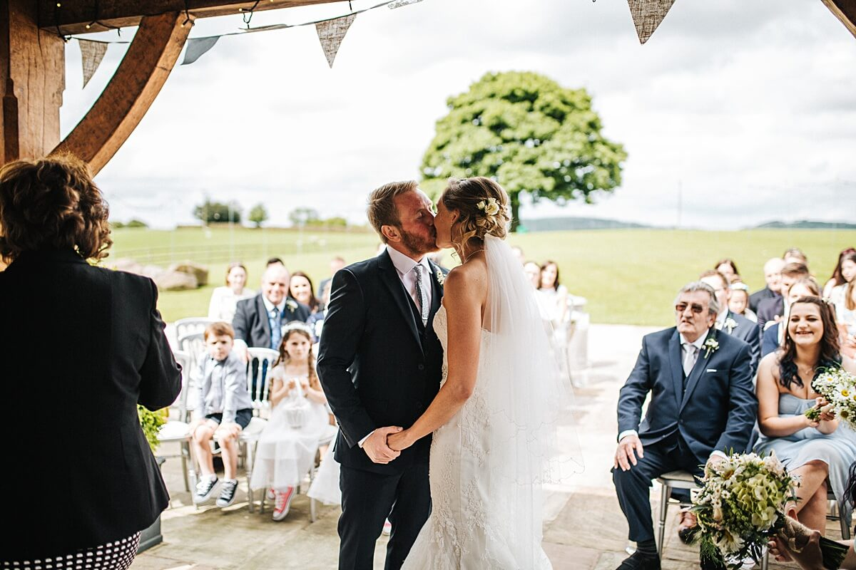 First kiss outdoor spring wedding