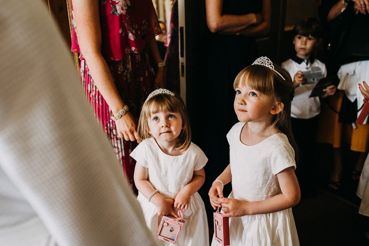Flower girls in their white dresses