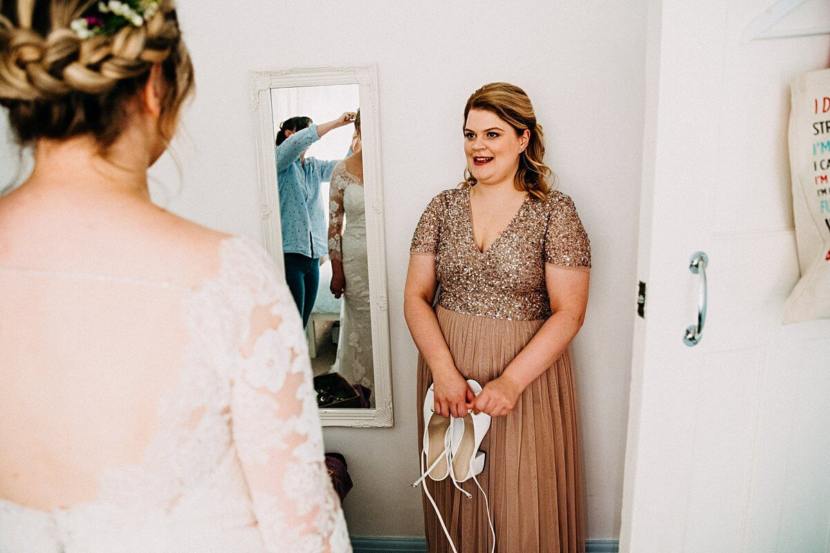 Bridesmaid in a gold glitter dress