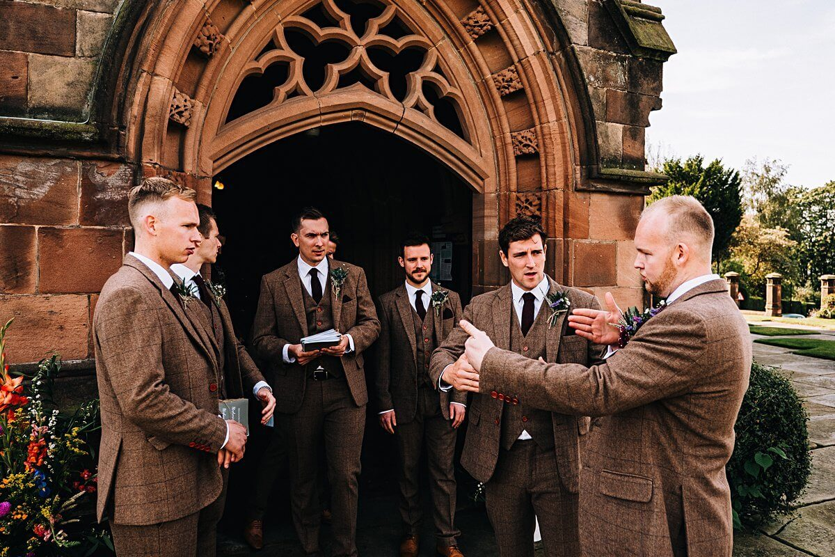 The ushers and groom in brown tweed suits