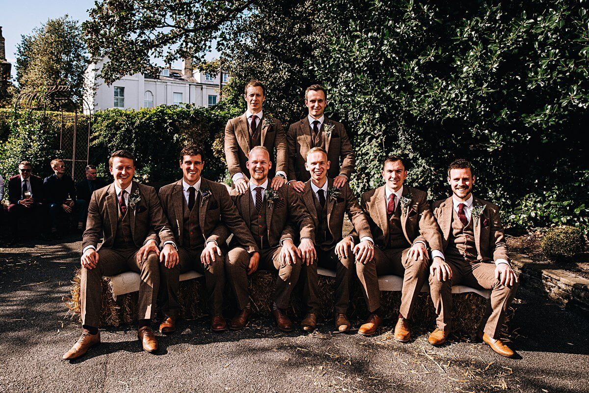 Ushers wearing brown tweed suits