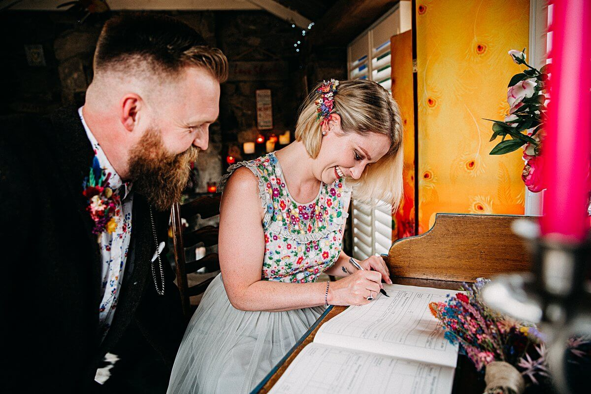 Signing the register at Lower Barns wedding