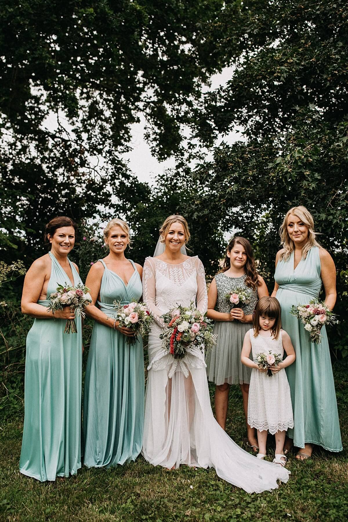 Bride and bridesmaids with mint green dresses