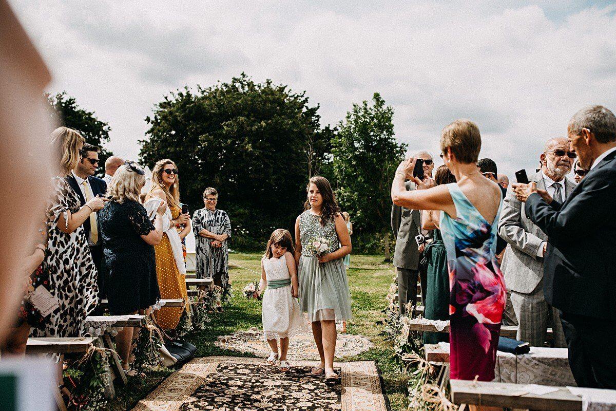 Bridesmaids walking down the aisle Norfolk wedding