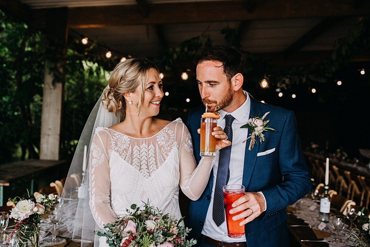 Bride and groom with a cocktail