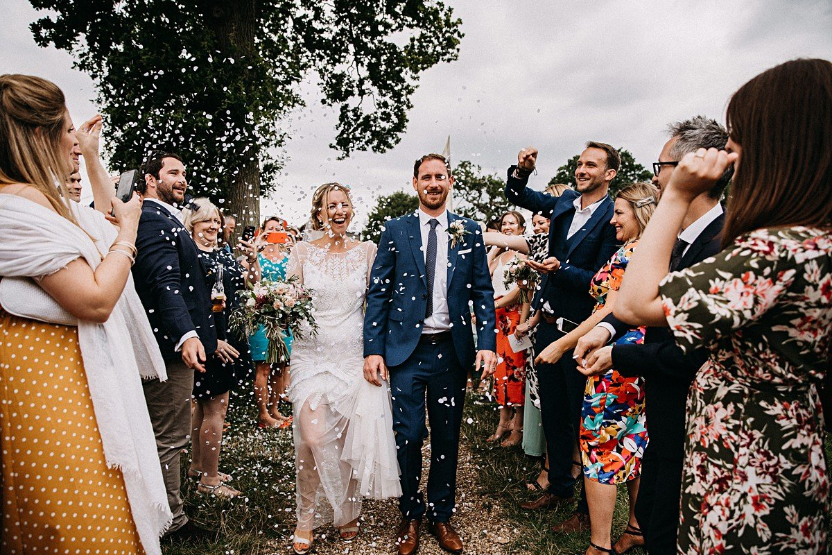 Confetti throwing at outdoor wedding
