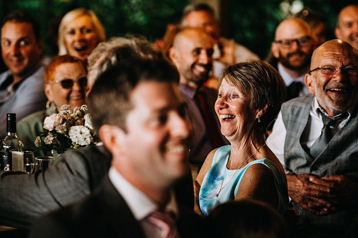Guests laughing at the wedding speech