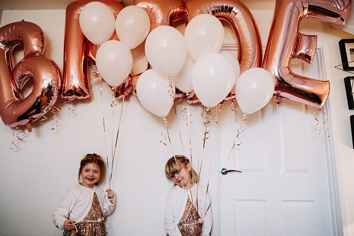 Flower girls holding balloons