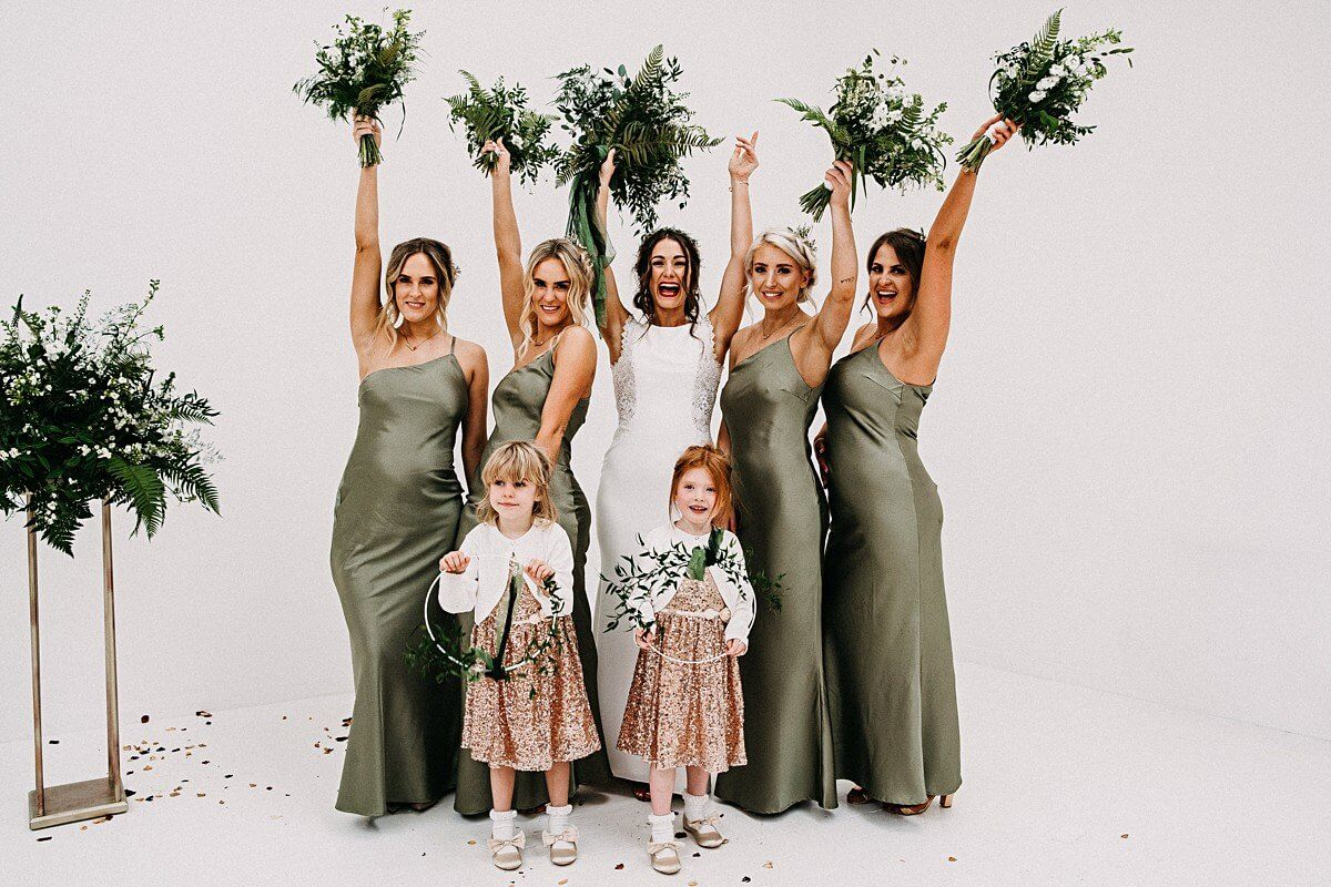 Bride and bridesmaids wearing sage dresses