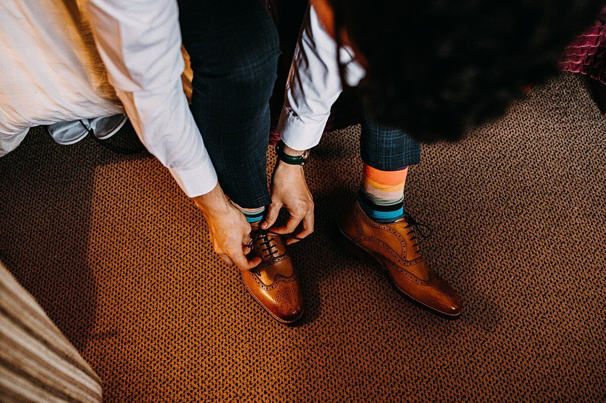 The groom wearing brown brogues