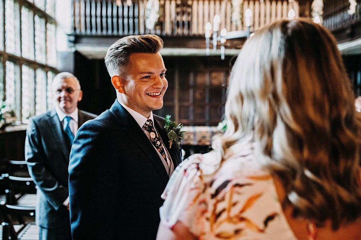 The groom smiling at guests at Yorkshire wedding