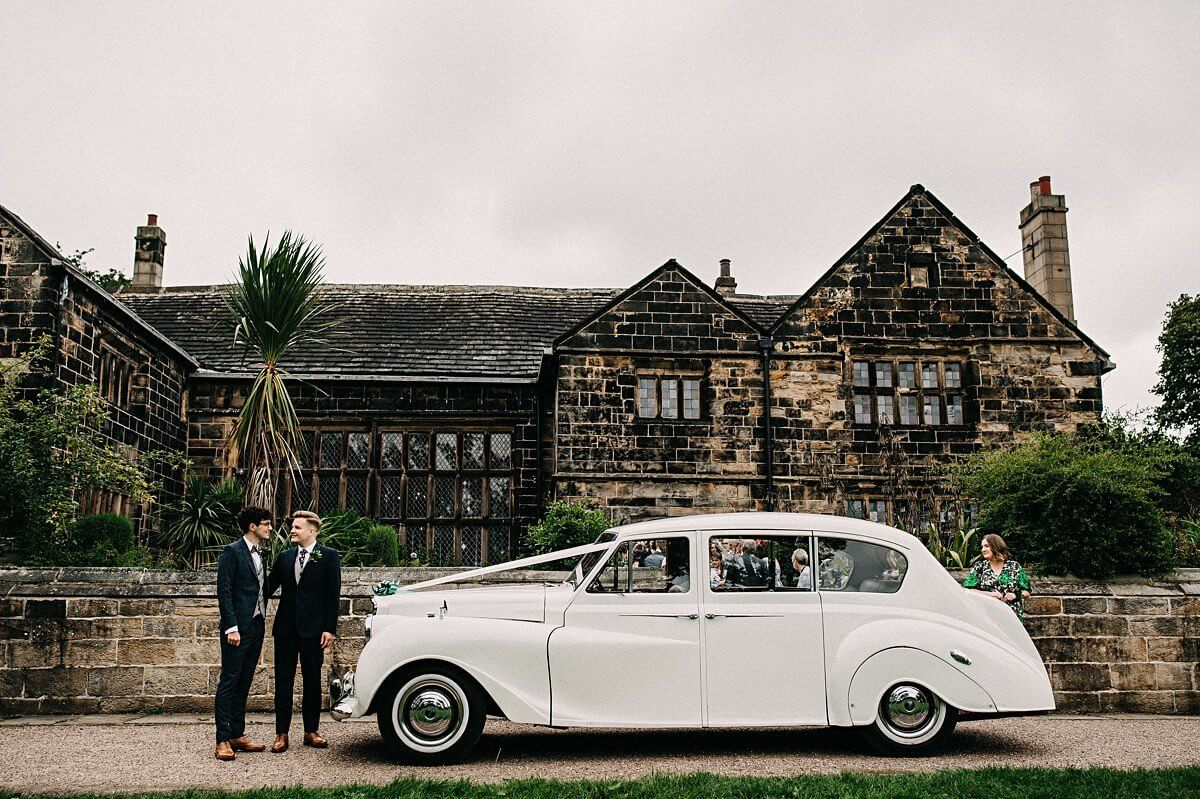 The grooms with their vintage white car