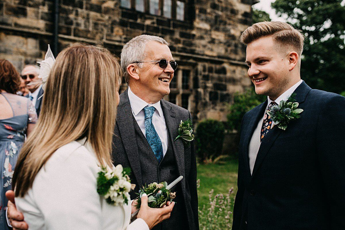 The groom greeting family members