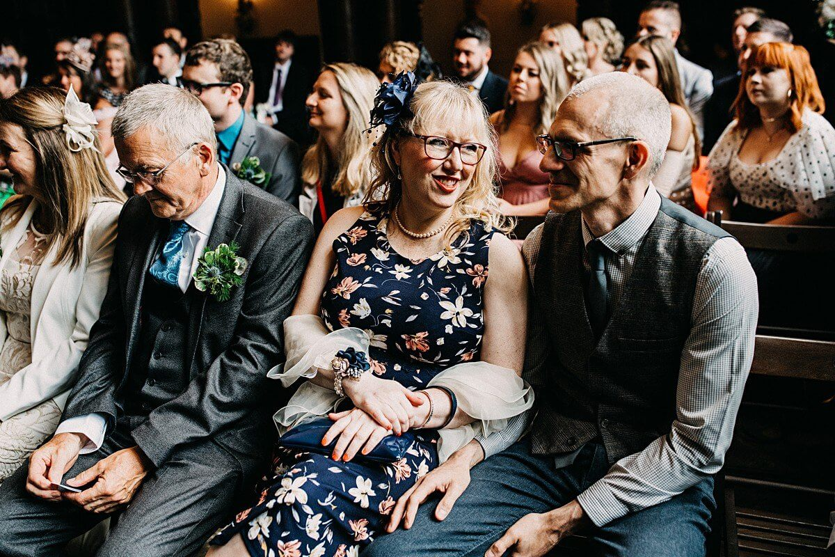 Guests laughing at the ceremony