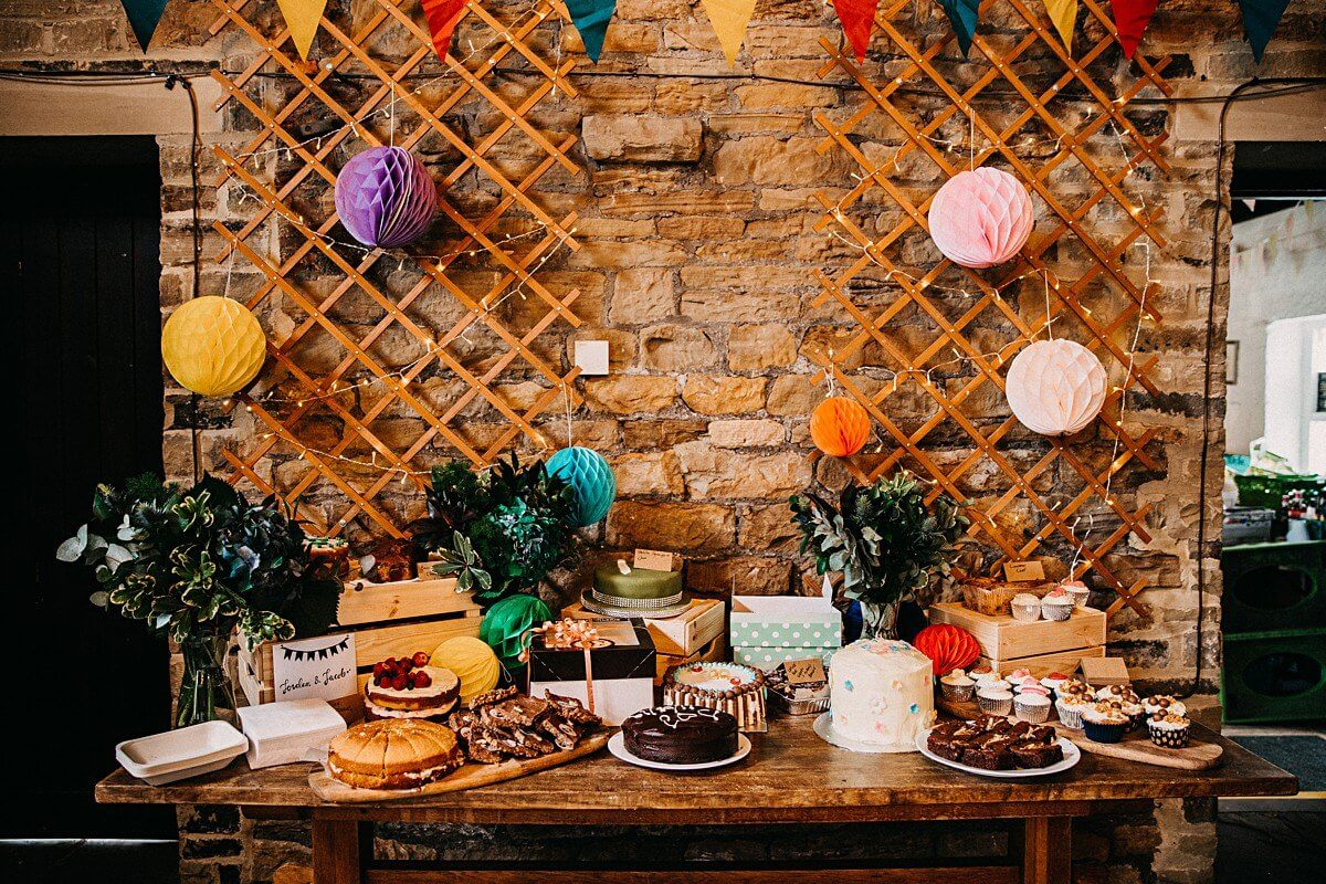DIY cake table at barn wedding Yorkshire