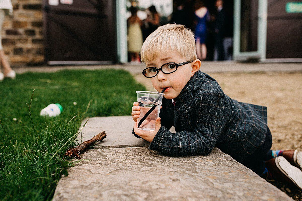 Cute kid at barn wedding