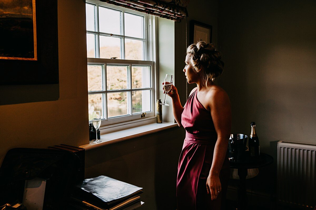 Bridesmaid enjoying a drink