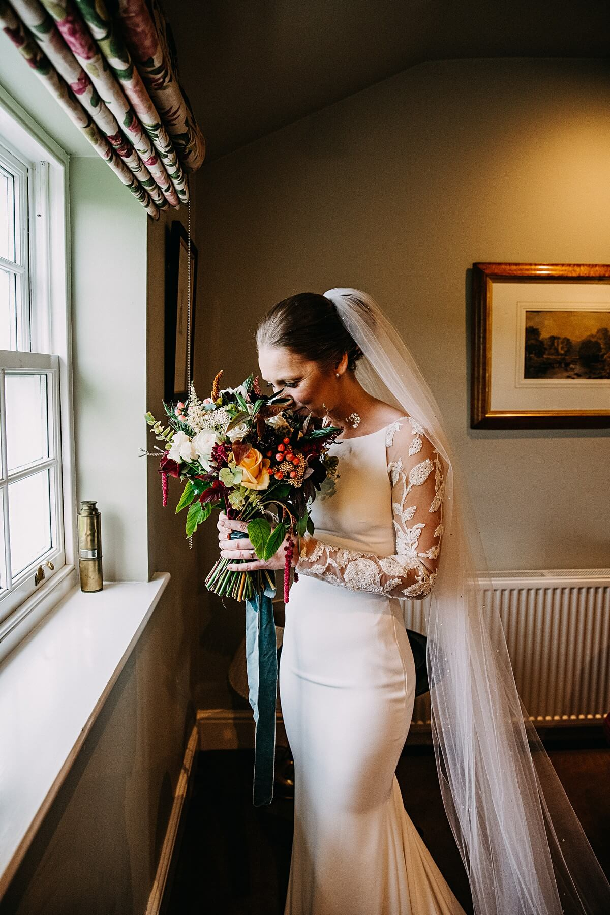 Bride holding her autumn bouquet