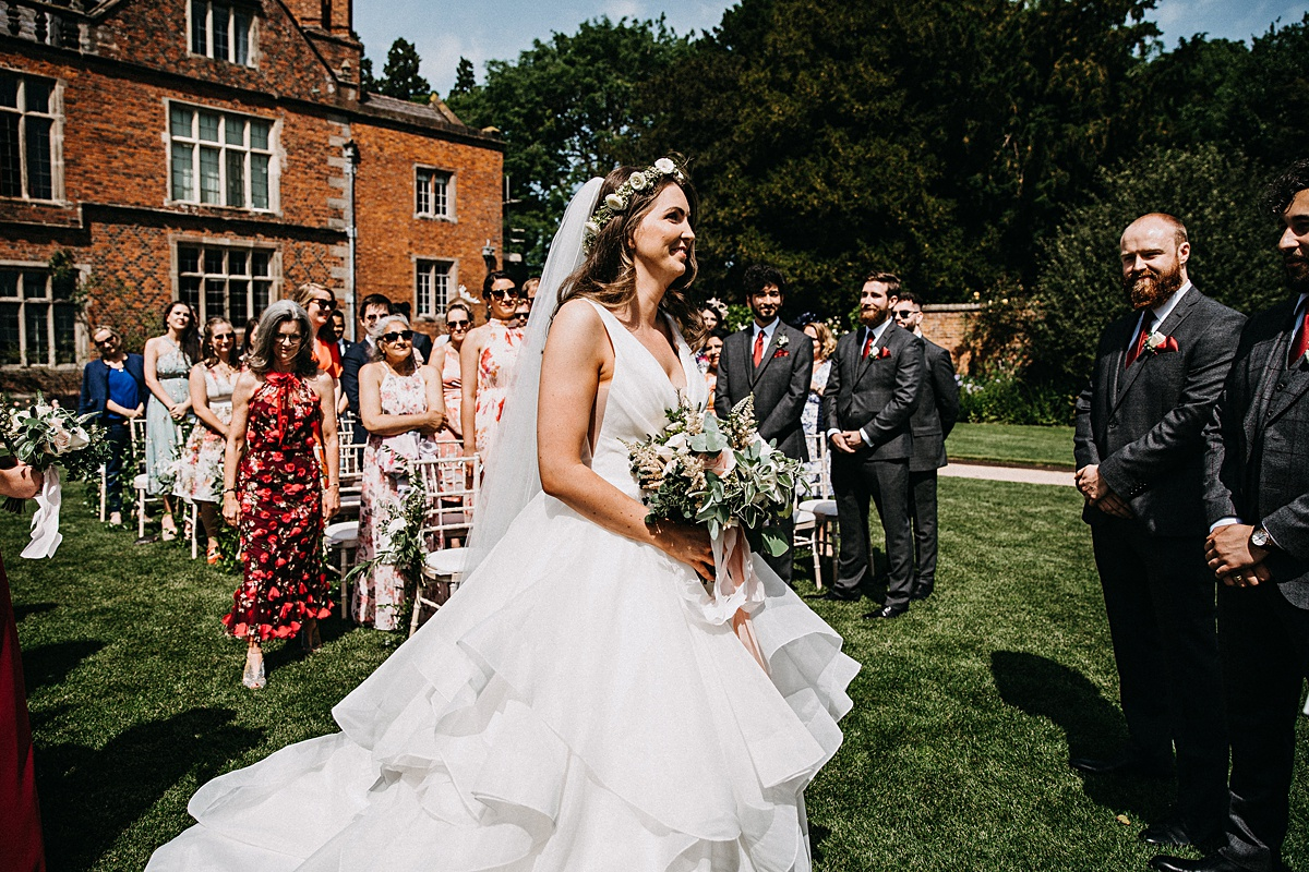Bride walking down the aisle at Dorfold Hall