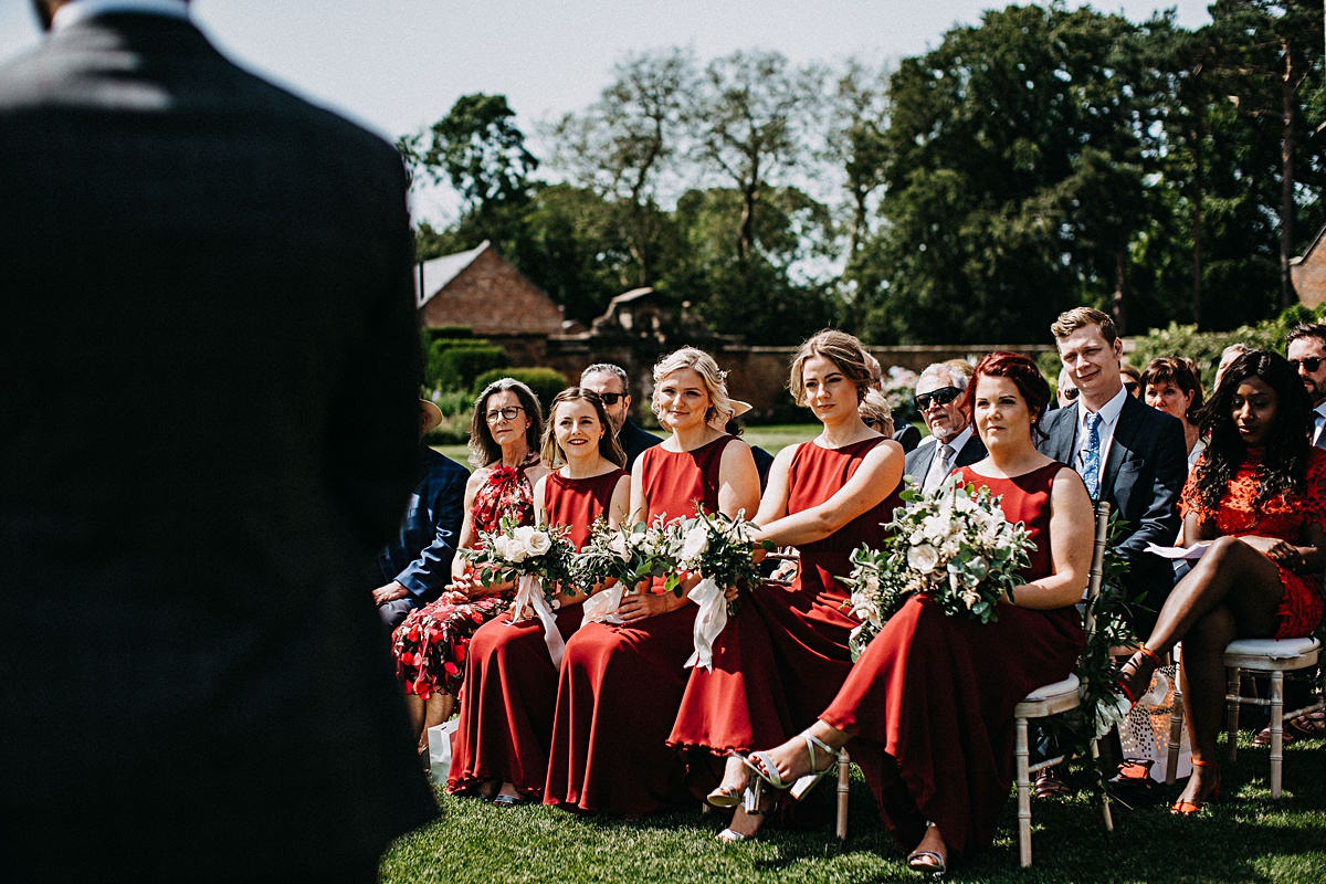Bridesmaids wearing maroon dresses
