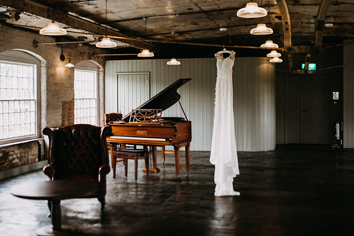 Wedding dress hung up a the industrial mill