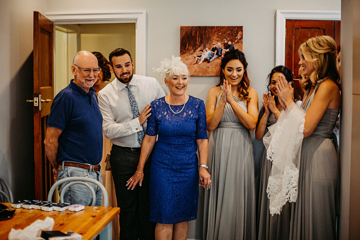 The family reacting to the bride's dress