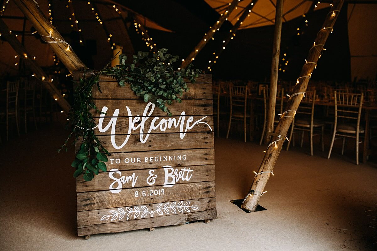 Rustic wedding sign tipi decor