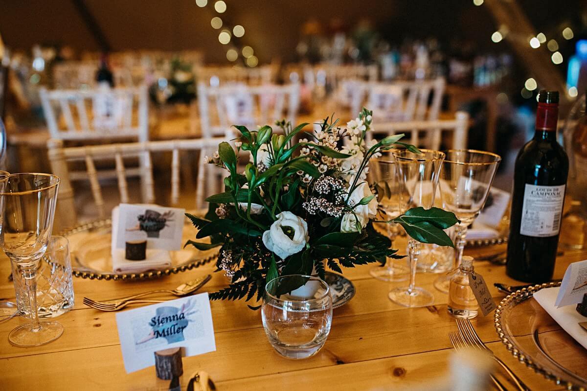 Floral tipi wedding table decoration