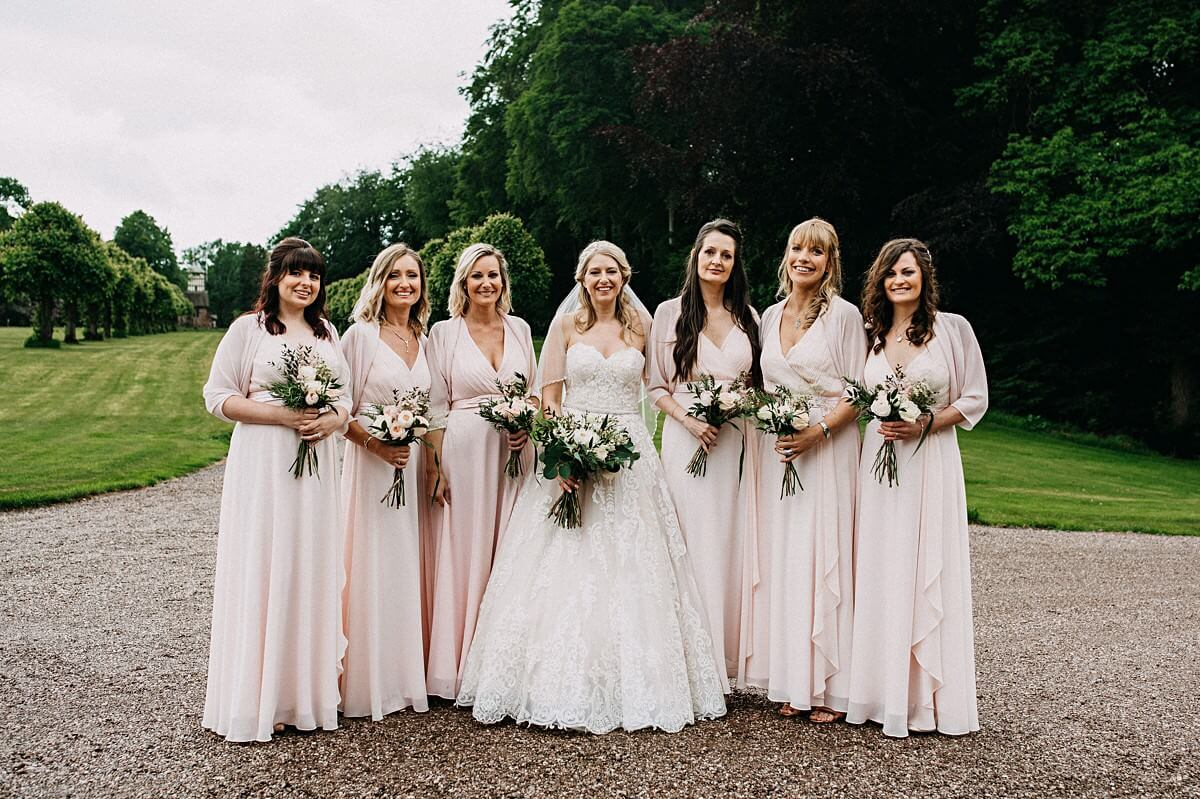 Bridesmaids wearing pink dresses with white and pink bouquets