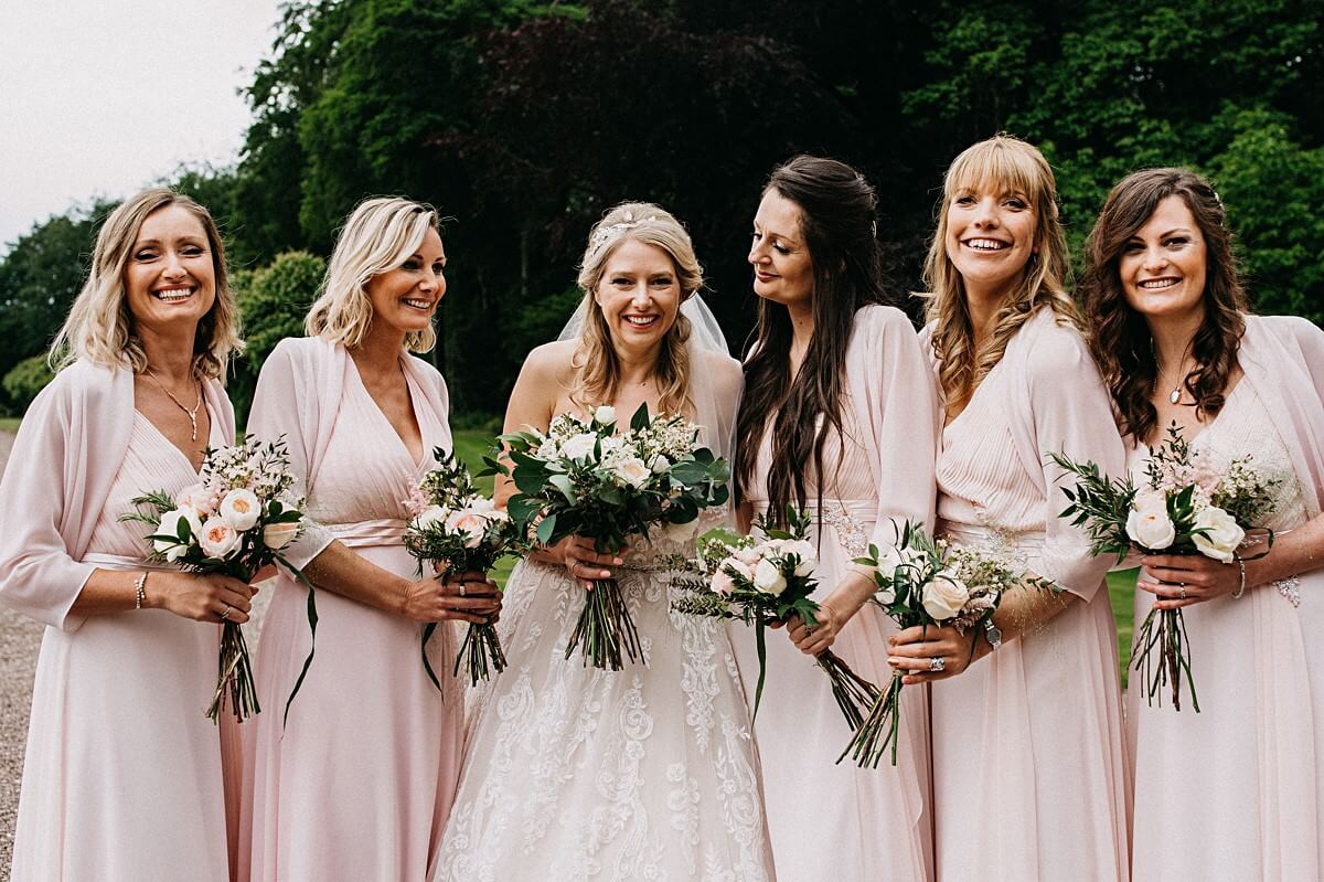 Natural photo of the bride and bridesmaids with their bouquets