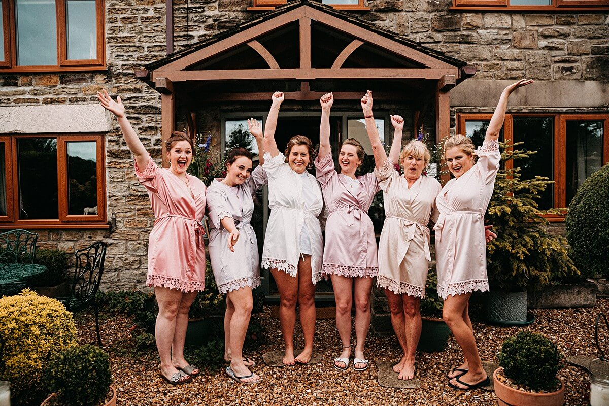 Bridesmaids celebrating with matching dressing gowns