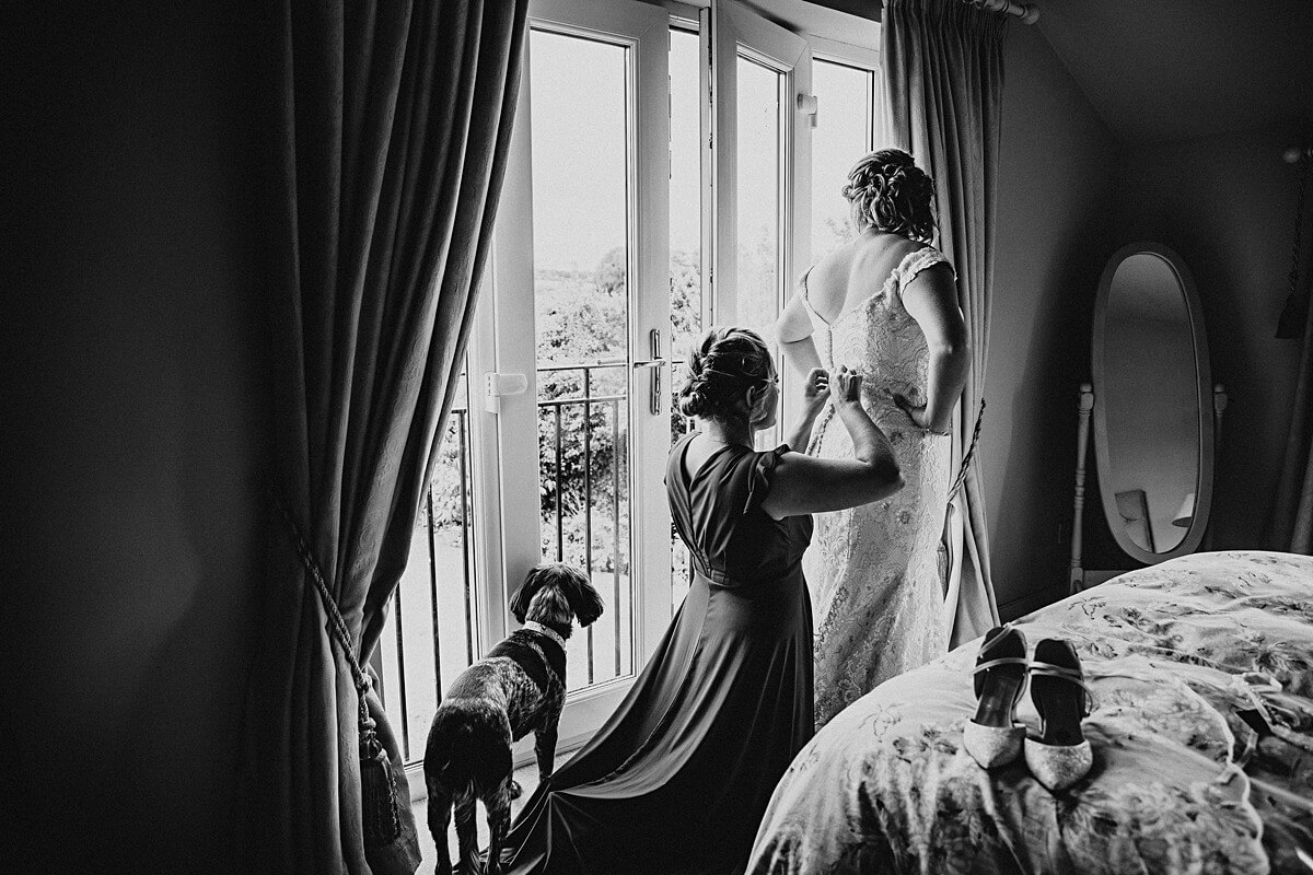Window portrait of the bride in her dress