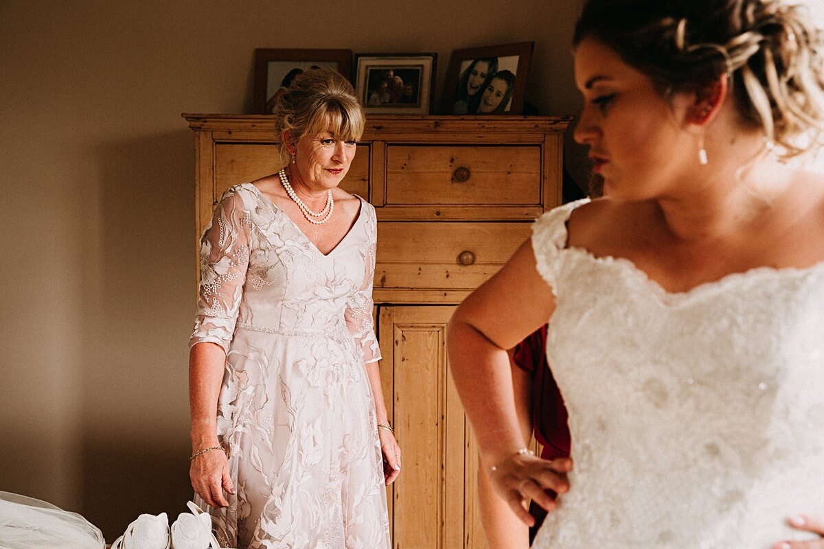 The bride's mum in a floral ivory dress