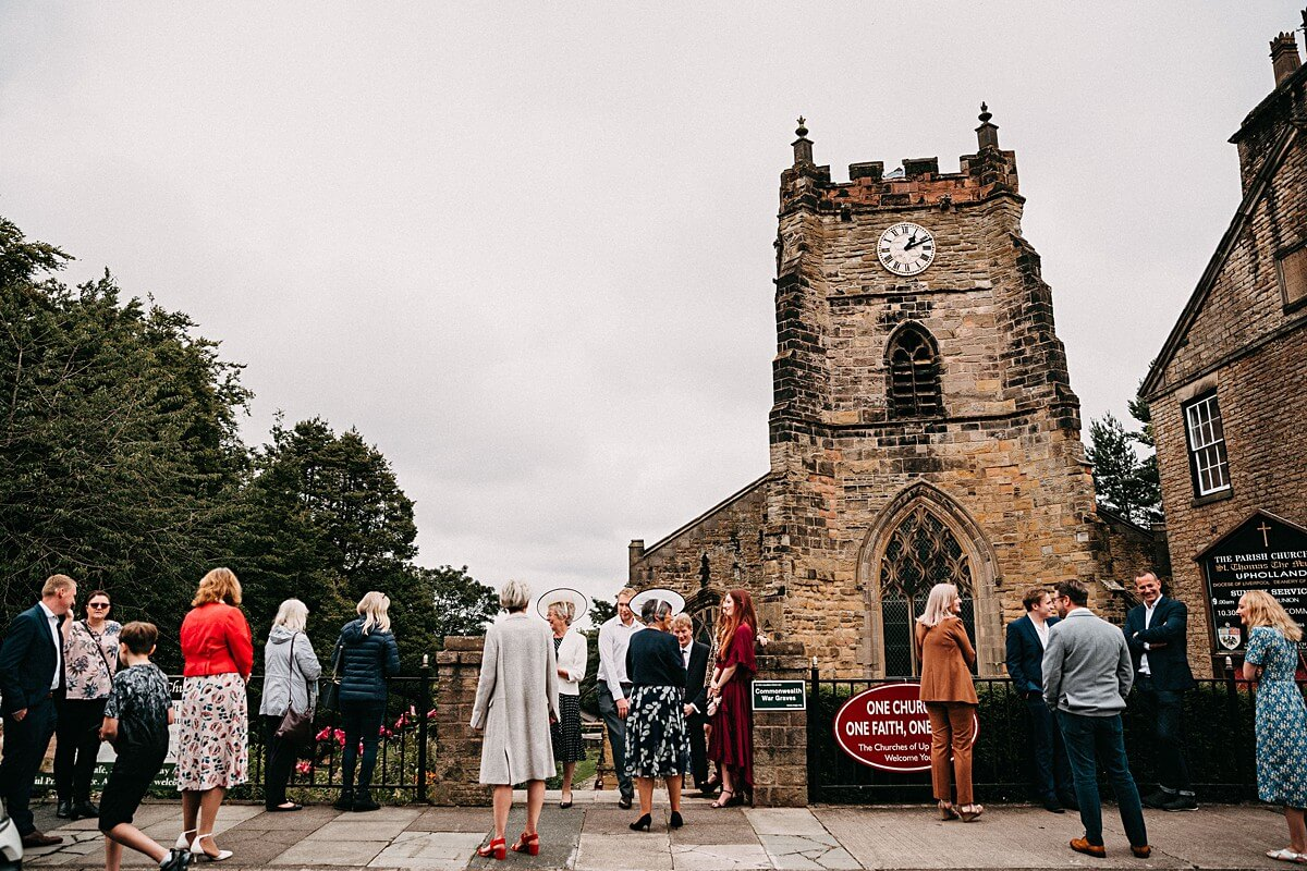 Wedding guests outside the church in Wigan Lancashire