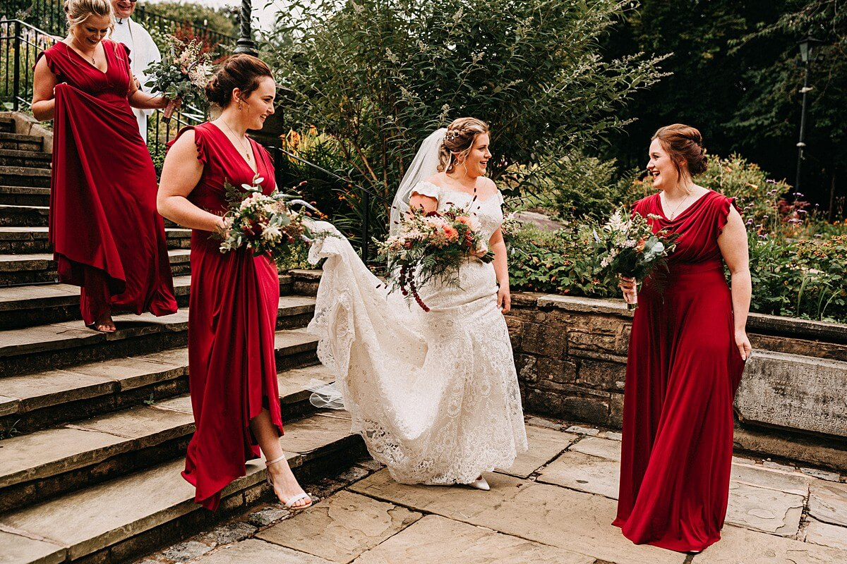 Bride in a lace dress with a colourful wild bouquet