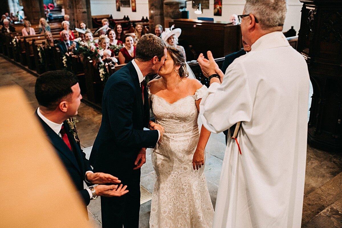 First kiss at the church wedding