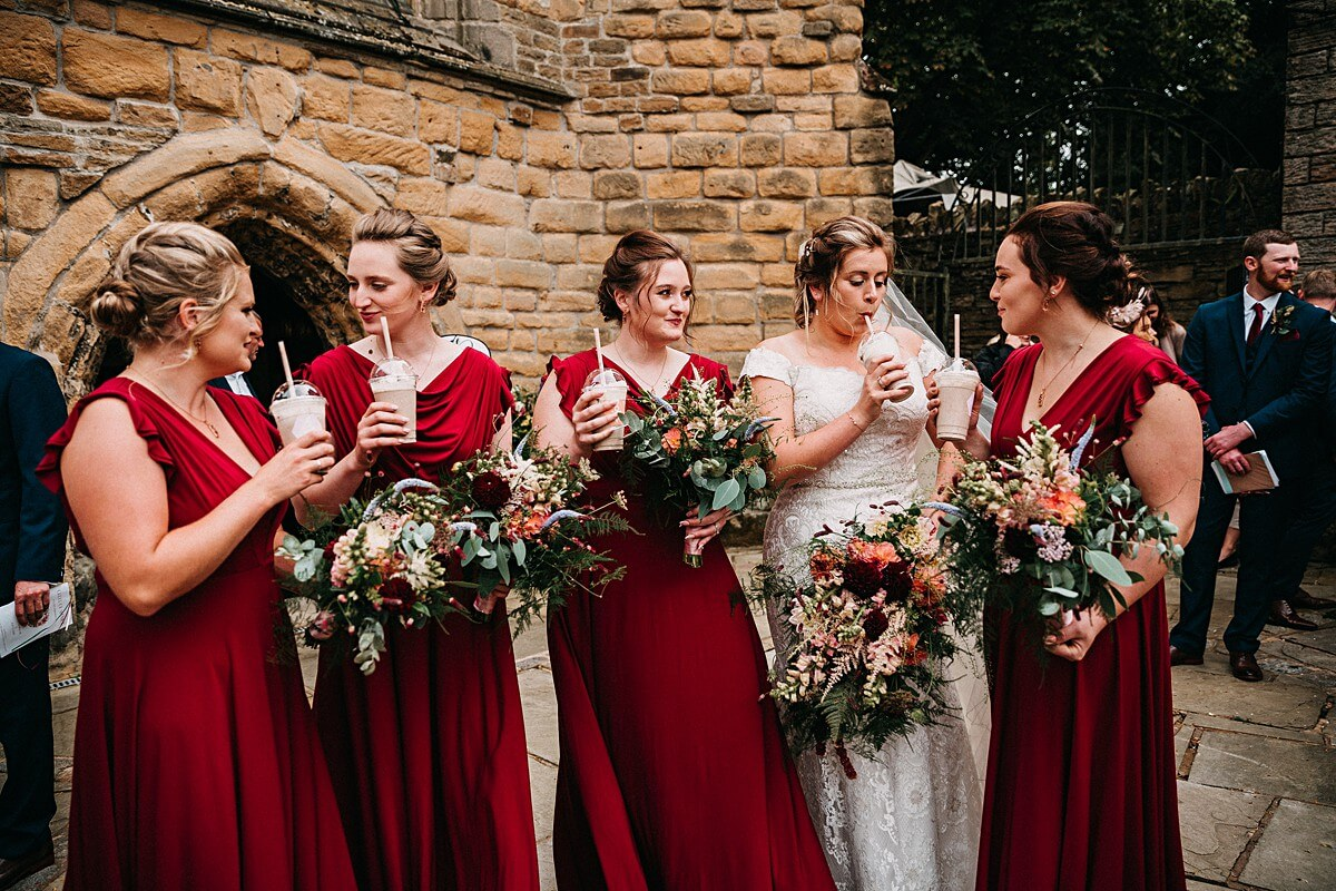 Bride and bridesmaids enjoying milkshakes