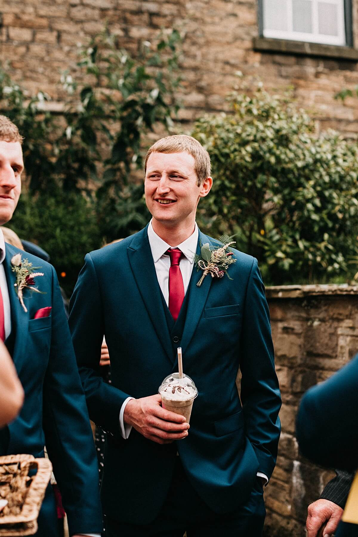 Natural portrait of the groom with a milkshake